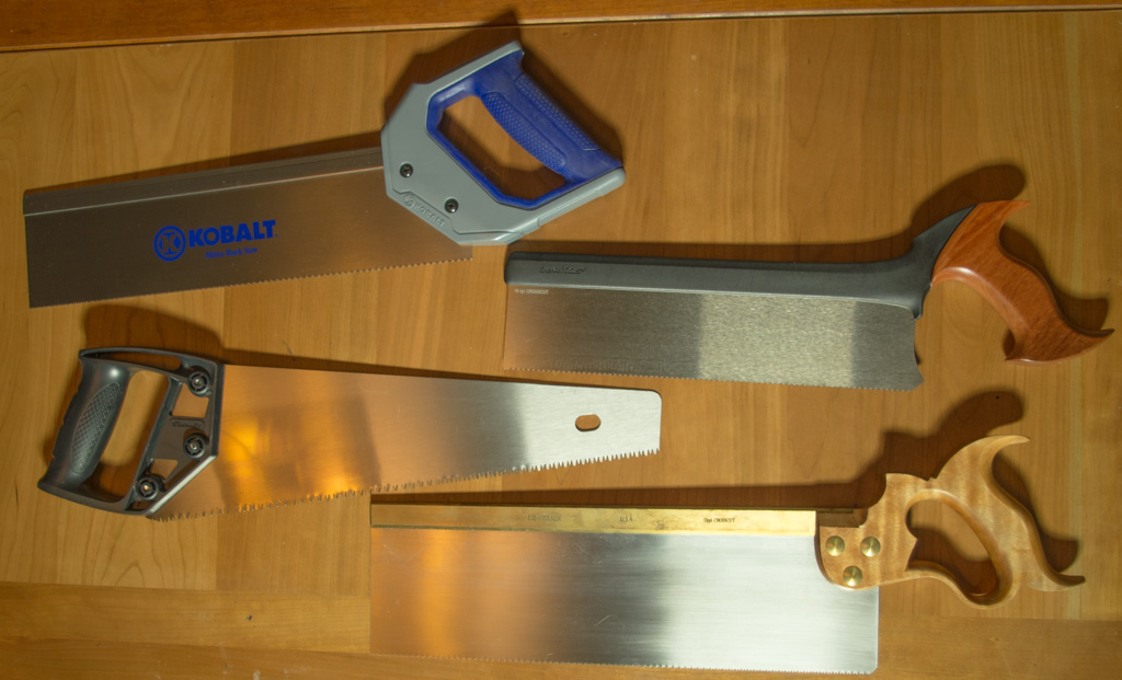 Crosscut saws: three backsaws and a panel saw (lower left).
