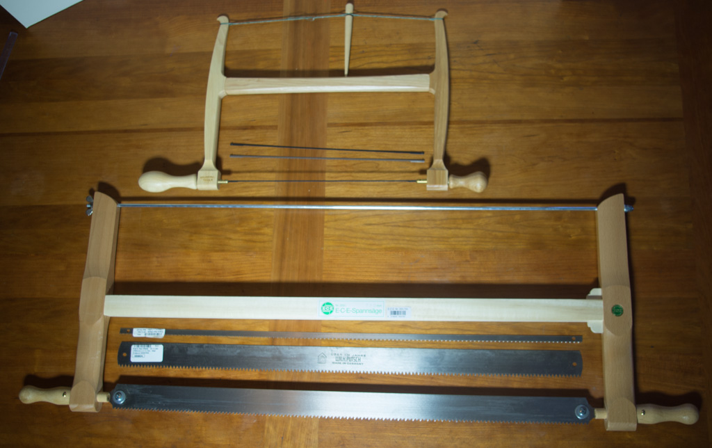 "A 12"" bowsaw and a 24"" frame saw, both with extra blades."