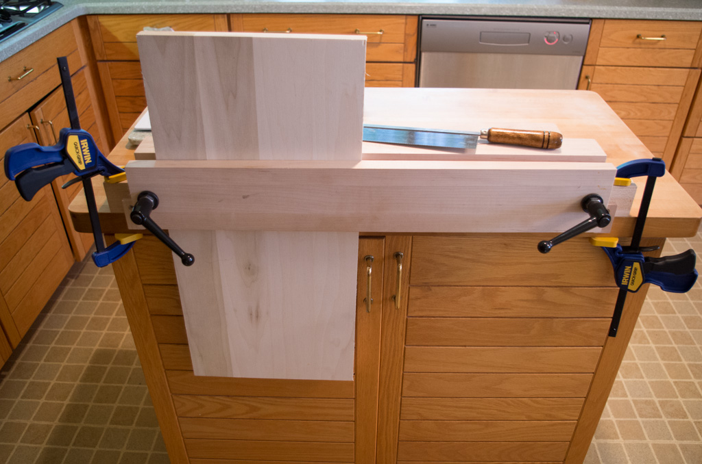 A vise clamped to a kitchen island.