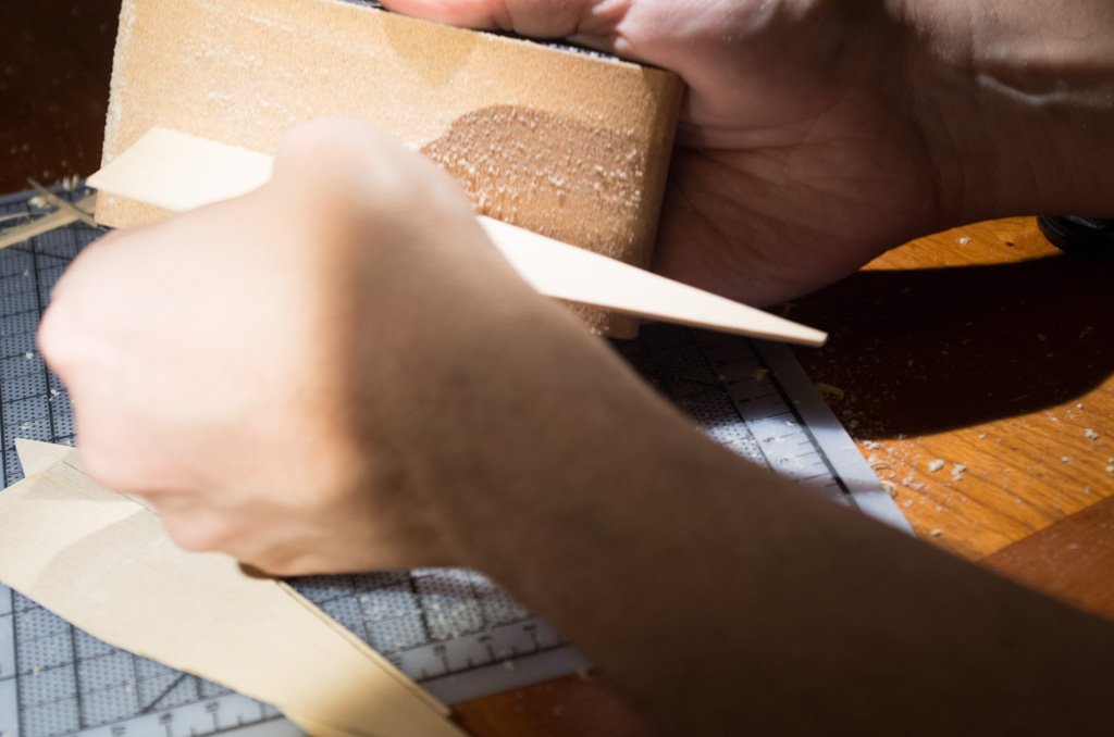 Sanding the edge of a marker