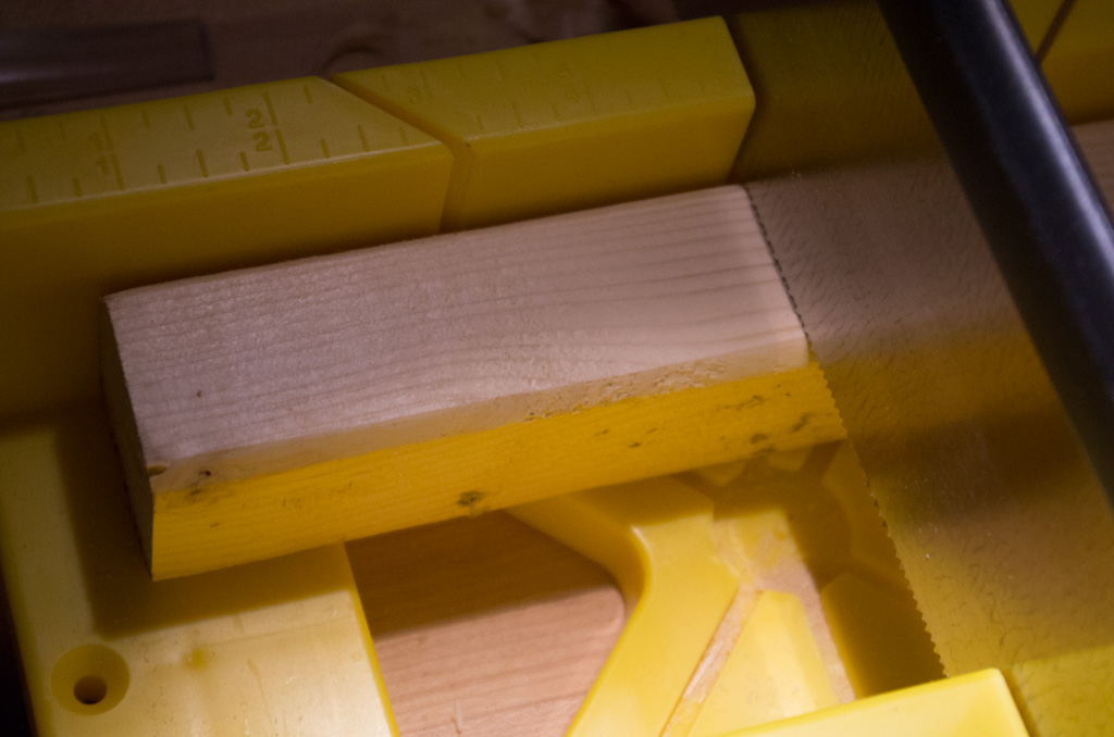 """Sawing a 4"""" piece in the miter box."""