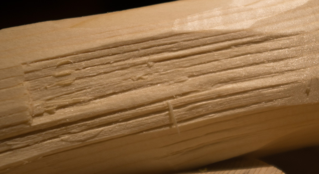 Cutting too quickly in the wrong direction in pine will split and leave ugly gashes in the wood.