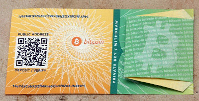 The bitcoinpaperwallet.com paper wallet with the private key concealed.