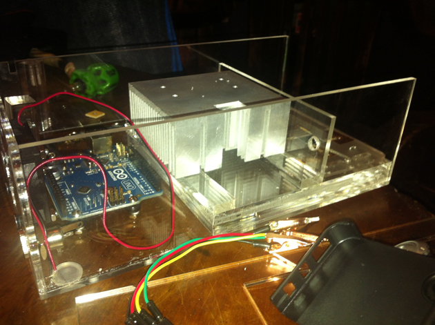 Arduino, paramecia stage, and heat sink within clear acrylic housing